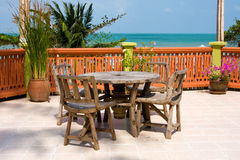 Table and chairs with a beautiful sea view . Stock Photography