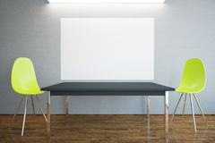 Table, chairs and billboard Stock Photo
