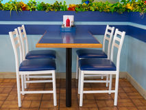 Table and chairs with blue theme Stock Images