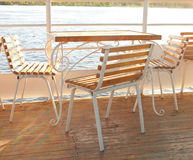 The table and chairs on the boat deck Royalty Free Stock Photo