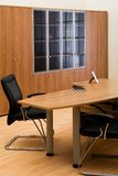 Table, chairs and bookcase Royalty Free Stock Photos