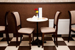 Table and chairs in cafe stock photo