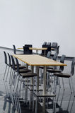 Table and chairs at cafeteria in modern building Royalty Free Stock Photos