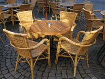 Table and chairs at the cobble stones Stock Images