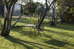 Table and chairs in a country house garden. Bingie. Australia. Royalty Free Stock Photo