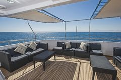 Table and chairs on deck of a luxury motor yacht Royalty Free Stock Images