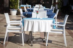 Table and chairs in empty cafe near the beach. Kemer, Turkey Royalty Free Stock Images