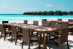 Table and chairs on exotic beach. Maldives Stock Photo
