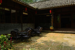 Table and chairs on flagstone yard of Chinese old building on su Royalty Free Stock Photo