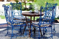 Table with chairs in the garden Stock Image