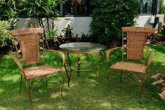 Table and chairs in the garden. stock image