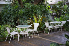 Table and chairs in a garden Stock Photo