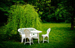 Table and chairs on the grass Royalty Free Stock Images