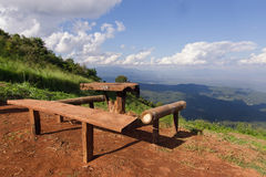 Table and chairs with grass, mountain and cloudy sky view of Chi Stock Photos