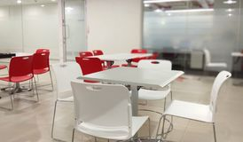 Table chairs in a hygienic dinning hall of an office. A hygienic dinning hall of an information technology company office royalty free stock image