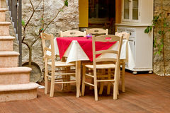 Table and chairs in Italy - country style. Table and chairs on a terrace - country style Stock Photography