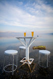 Table and chairs, by the lake Royalty Free Stock Photography
