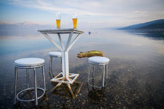 Table and chairs, by the lake Royalty Free Stock Photos