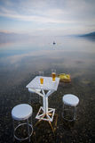 Table and chairs, by the lake Stock Image