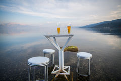 Table and chairs, by the lake Royalty Free Stock Images