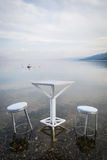 Table and chairs, by the lake Royalty Free Stock Photo