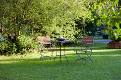 Table and chairs on a lawn. At the garden Royalty Free Stock Photo