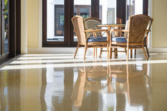 Table and chairs in living room with reflection Royalty Free Stock Photo