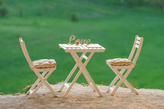 Table, Chairs and Love Word Royalty Free Stock Photography