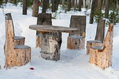 Table and chairs made of tree trunks Royalty Free Stock Image