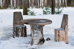 Table and chairs made of tree trunks Royalty Free Stock Photography