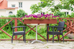 Table and chairs of modern european outdoor cafe Royalty Free Stock Image