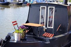 Table and chairs on narrowboat. Royalty Free Stock Photography