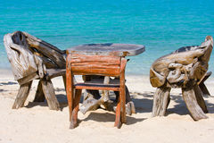 Table and chairs near the sea Stock Photos
