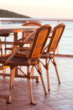 Table and chairs near the sea Royalty Free Stock Photos