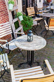 Table and chairs of an outdoor cafe Stock Images