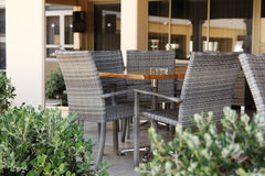 Table and chairs outside the restaurant Stock Photography