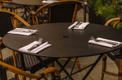Table with chairs outside the restaurant Stock Photos