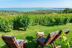 Table and chairs over the Lake Balaton on the hill romantic date, picnic, eating on nature. Csopak wine tasting. With view stock photos