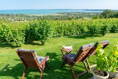 Table and chairs over the Lake Balaton on the hill romantic date, picnic, eating on nature. Csopak wine tasting. With view stock images