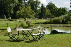 Table and chairs in park, Ludwigsburg Royalty Free Stock Photography
