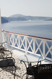 Table with chairs patio oia ia santorini caldera Royalty Free Stock Image