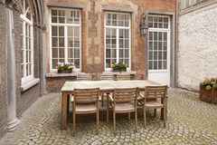 Table and chairs in patio Royalty Free Stock Images
