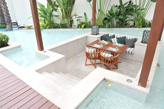 Table and chairs in pool Stock Photography
