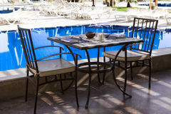 Table and chairs by the pool, Breakfast in Ibiza Stock Photos