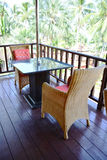 Table and chairs rattan in restaurant indoor. Royalty Free Stock Photo