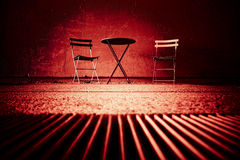Table and Chairs on Red Royalty Free Stock Image
