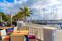 Table with chairs in restaurant in Puerto Calero marina Royalty Free Stock Photography