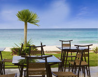 Table and chairs in restaurant on tropical beach Royalty Free Stock Photo