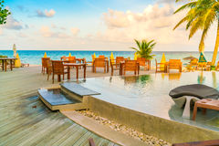 Table and chairs at restaurant in tropical Maldives island . Royalty Free Stock Photos