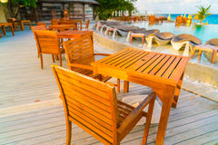 Table and chairs at restaurant in tropical Maldives island . Stock Photos